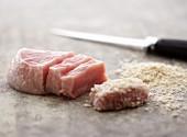 Sliced Pork being Breaded