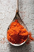Ground paprika on a spoon (view from above)