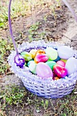 An Easter Basketon the Ground with a Variety of Decorative Eggs