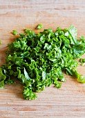 Chopped mustard greens on a wooden Cutting Board