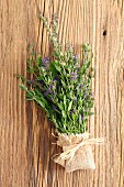 Fresh hyssop with flowers on a wooden surface