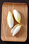 Chicory on a wooden tray