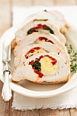 Turkey breast stuffed with egg, spinach and red peppers