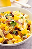 Ribbon pasta with squash, red onions, dried cranberries and pumpkin seeds