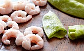 Shrimp next to Sugar Snap Peas
