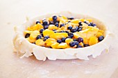 Making a Blueberry and Peach Pie