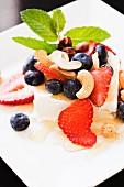 Fresh Yogurt with Honey, Strawberries, Blueberries, Mint and Cashews