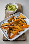Deep-fried sweet potato wedges with houmous