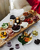 Dining table selection of antipasto with red wine