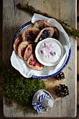 Mini pancakes with berries and yoghurt sauce