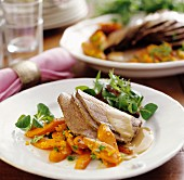 Slices of roast beef with carrots and salad