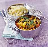 Fusilli and peppers with dill and capers in camping pots