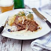 Roast pork with onion sauce and potatoes
