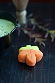 A wagashi maple leaf (momiji) and matcha tea