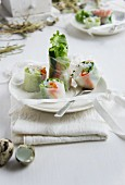 Rice paper rolls filled with spring vegetables and prawns