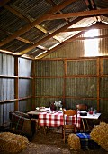 A table laid in a barn