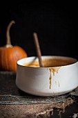 A Pot of Caramel with a Pumpkin in the background