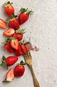 Fresh strawberries, some crushed with a fork