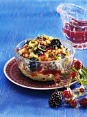 Coconut and saffron rice with blackberries