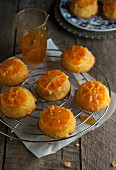 Mini upside-down clementine cakes on a wire rack
