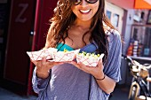 Woman with takeaway food, Hermosa Beach, California, USA