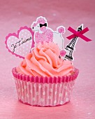 A pink cupcake with romantic decoration for Valentine's Day