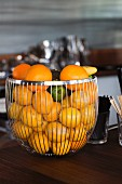 Mixed Citrus Fruit in a Wire Basket on a Bar