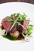 Rare Bavette Steak with Onion and Arugula