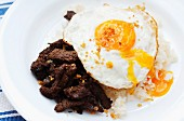 Tapsilog (beef with rice and fried egg - traditional breakfast dish in the Philippines)