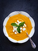 Cream squash soup served with feta cheese.