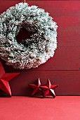 Festive wreath and red stars