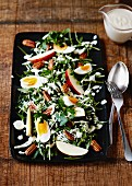 Rocket salad with apple wedges and boiled eggs