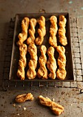 Freshly baked cheese straws on a baking tray