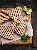 Quesadillas and wedges of lime