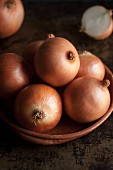 Brown onions in a clay dish