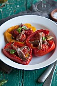 Stuffed roasted peppers with anchovies and basil