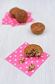 Banana muffins with chocolate on spotted paper napkins