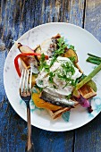 A waffle with sardines and peppers