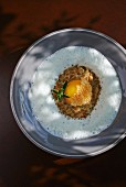 Spelt risotto with egg and a truffle sauce