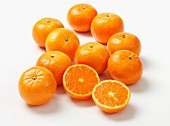 Several clementines, whole and halved
