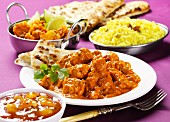 Chicken tikka masala with chutney, rice and naan bread (India)