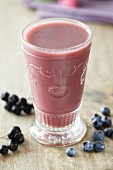 Berry smoothie with blueberries and blackcurrants