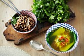 Pasta with sesame seeds and noodle soup with bok choy (Asia)