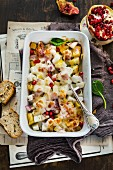 Cheese-topped turnip bake with pomegranate seeds