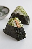 Onigiri in sheets of nori (spiced rice balls, Japan) with salmon filling
