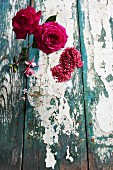 Roses and lilac on weathered wooden table