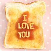 A slice of toast with spaghetti letters spelling out I LOVE YOU
