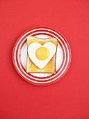 Toast topped with a fried egg heart (view from above)