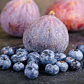 Blueberries and figs with droplets of water