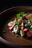 Savoury strawberry salad with new potatoes and cress